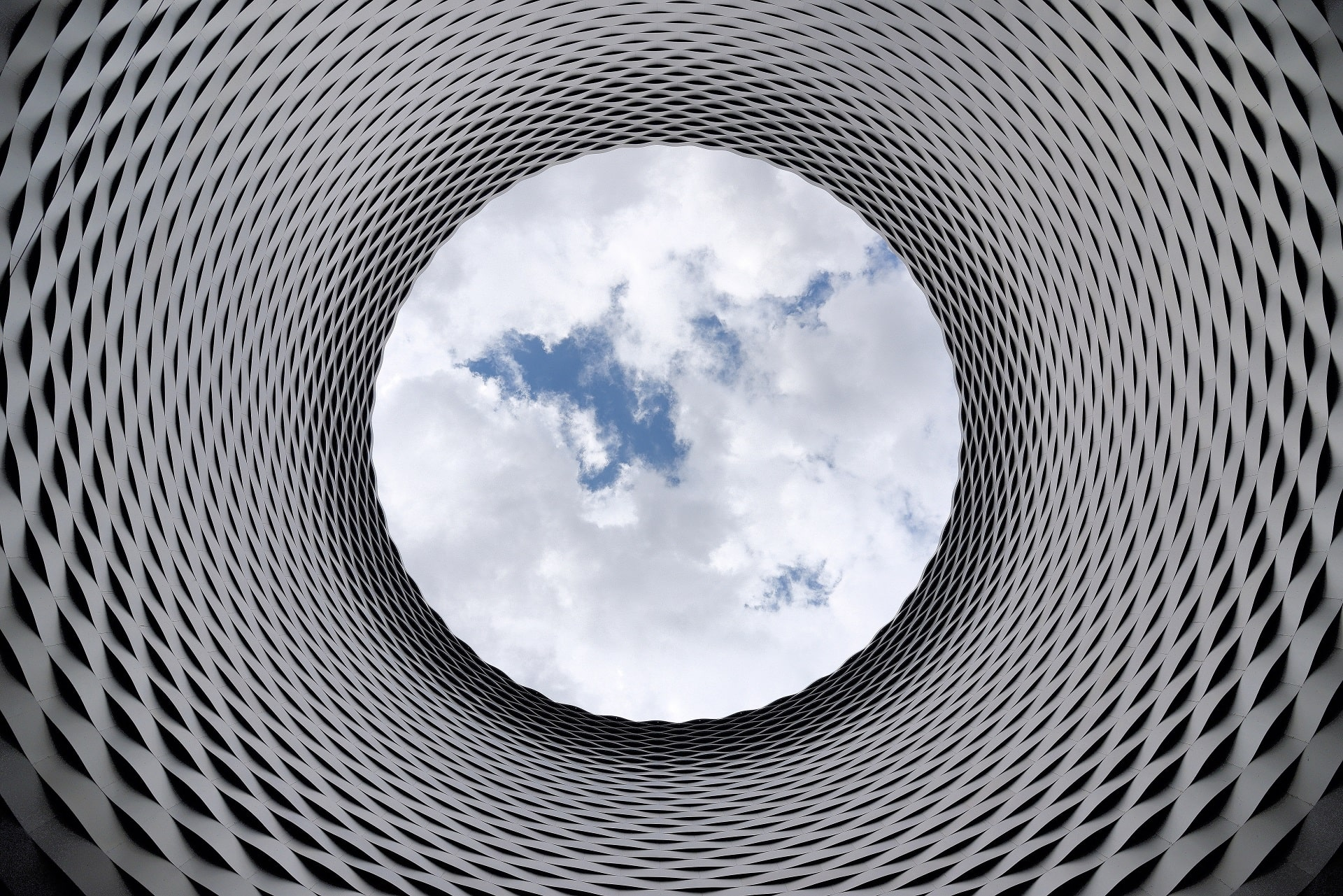 Cloud Services in San Jose, CA--represented by a view of clouds through a cylindrical sculpture.